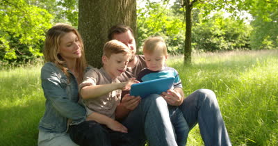Family sharing Fond memories on a iPad after scanning a memorial QR coded Tag