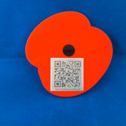 Stainless Steel Tag surrounded by Red acrylic poppy shape with black centre to represent a poppy flower